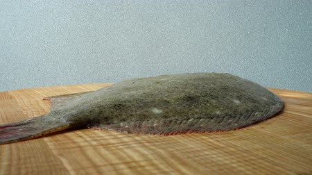 seafood dishes : Fish of flatfish on a cutting board.