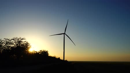 natural resource : Wind farm. Wind turbine. Shooting at a sunset.