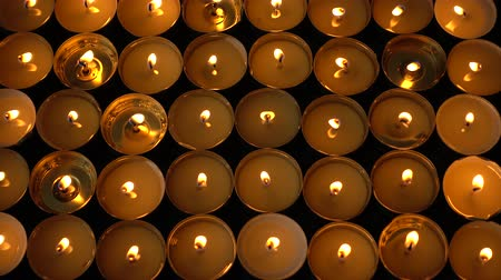 spotlights : Candles on a black background.