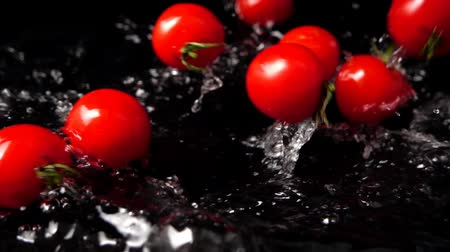 dalmak : Water drops on black background. Slow motion.