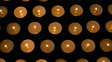oltář : Candles on a black background.