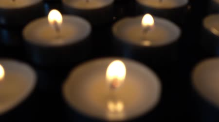 воспоминания : Candles on a black background.