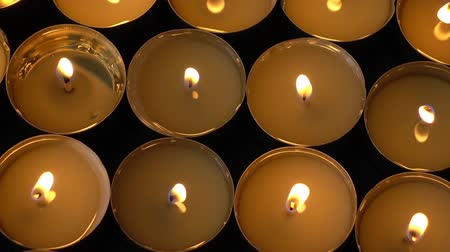 şamdan : Candles on a black background.