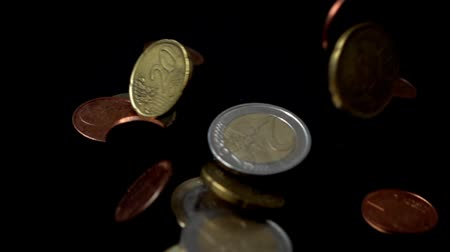 kuruş : Coins fall on a black background. Slow motion.