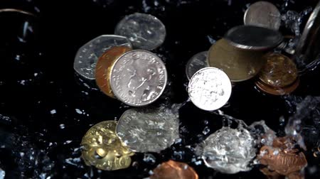 kuruş : Coins fall in water. Slow motion. Stok Video