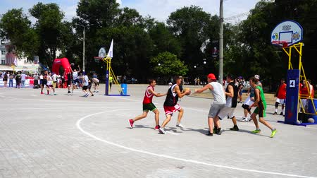 streetball : UKRAINE, BERDYANSK - JULY 6, 2019: Public competitions in Streetball. Slow motion. Stock Footage
