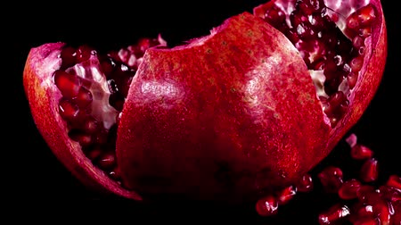 unpeeled : Pomegranate on a black background. Shooting on a black background. Stock Footage