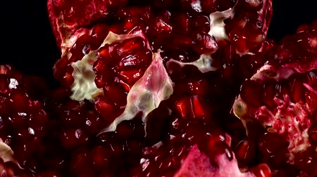 산화 방지제 : Pomegranate on a black background.