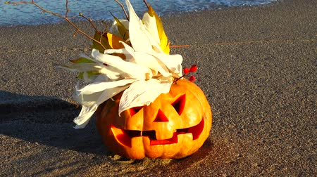 jack olantern : Spooky halloween pumpkin. Shooting on the beach. Stock Footage
