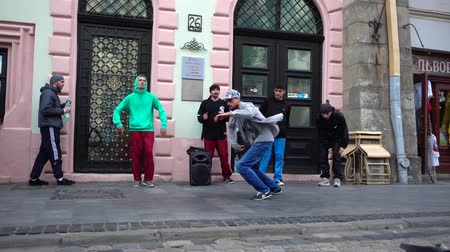 breakdancing : LVIV, UKRAINE - AUGUST 28, 2019: Unknown guys dance break on the street of the city. Slow motion.