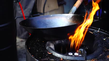 vegetable wok : Asian cuisine. Cooking in a wok pan. Slow motion.