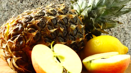 tápanyagok : Still life from pineapple, apples and lemons. Healthy food. Stock mozgókép