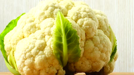 macro shooting : Shooting of cauliflower in the movement. Cuttig board.