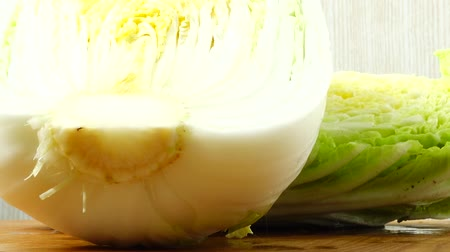 macro shooting : Napa cabbage, shooting in the movement. Cuttig board. Stock Footage