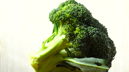 brocoli : Shooting of broccoli in the movement. Cuttig board.