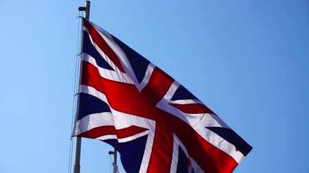 brexit : Flag of Great Britain against the blue sky. Stock Footage