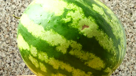 rind : Watermelon on a kitchen board. Shooting in the movement.