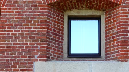 brickwall : Brick wall and windows of the house. Stock Footage