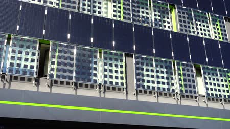 pane : Solar panels on the building wall.