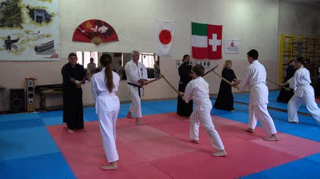 combativo : LVIV, UKRAINE - OCTOBER 26, 2019: Budo-Marathon 2019. Participants of the marathon practice techniques of Japanese fencing. Stock Footage