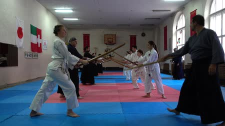 scherma : LVIV, UKRAINE - OCTOBER 26, 2019: Budo-Marathon 2019. Participants of the marathon practice techniques of Japanese fencing. Filmati Stock