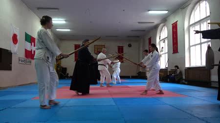 フェンシング : LVIV, UKRAINE - OCTOBER 26, 2019: Budo-Marathon 2019. Participants of the marathon practice techniques of Japanese fencing. 動画素材