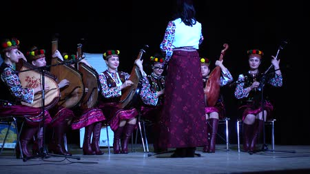 naladit : LVIV, UKRAINE - NOVEMBER 10, 2019: Lviv Bandur Fest 2019. Performances of folk bands using the musical instrument bandura.
