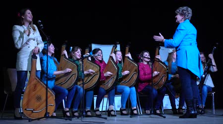 concierto de música clásica : LVIV, UKRAINE - NOVEMBER 10, 2019: Lviv Bandur Fest 2019. Performances of folk bands using the musical instrument bandura.