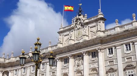 real madrid : Royal Palace of Madrid. Spain Flag over the palace and clouds. Stock Footage