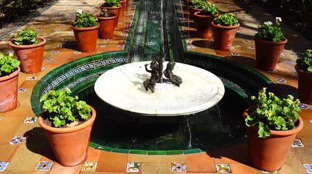díszített : MADRID, SPAIN - MARCH 27, 2018: The fountain in the yard of the house-museum of Sorolla. The house has been built in 1909 - 1910.