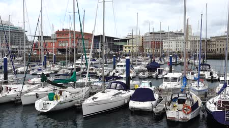 tengeri kikötő : LA CORUNA, SPAIN - APRIL 1, 2018: The embankment and yachts in La Coruna. La Coruna the large city in the northwest of Spain, the resort and the port. Stock mozgókép