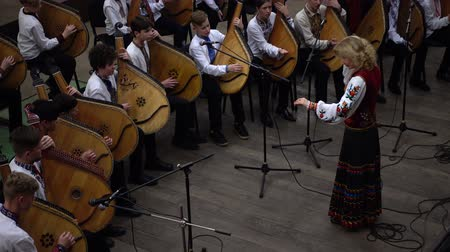 naladit : LVIV, UKRAINE - NOVEMBER 18, 2019: Kobza Art Festival Ring, Bandura! Performances of folk bands using the musical instrument bandura.