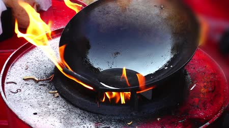 wok food : Asian cuisine. Cooking in a wok pan. Slow motion.