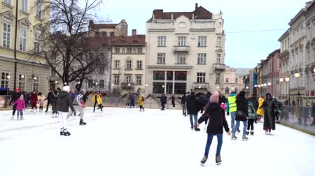 ice skating : LVIV, UKRAINE - DECEMBER 15, 2019: Unknown people skate in the square of the city.