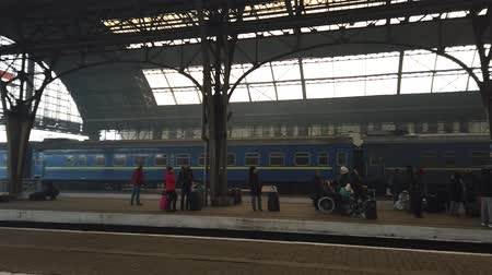 mozdony : LVIV, UKRAINE - DECEMBER 21, 2019: Shooting of the train. Shooting at the Ukrainian railway station. Stock mozgókép