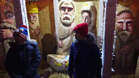 hristiyanlık : LVIV, UKRAINE - DECEMBER 25, 2019: Christmas nativity scene. Stok Video
