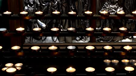 plafond : Votive candle. Shooting of the Catholic Cathedral. Stockvideo