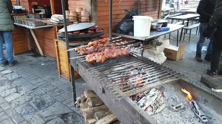 špejle : IVANO-FRANKIVSK, UKRAINE - JANUARY 7, 2020: The process of preparing a barbecue on a mangal.