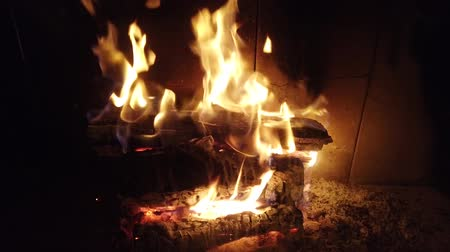 bricks : Fire in a fireplace. Fire shooting. Stock Footage