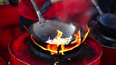 kluski : Asian cuisine. Cooking in a wok pan. Slow motion.