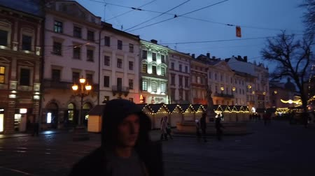 godo : LVIV, UKRAINE - JANUARY 21, 2020: Unknown people walk around the historical part of the city.