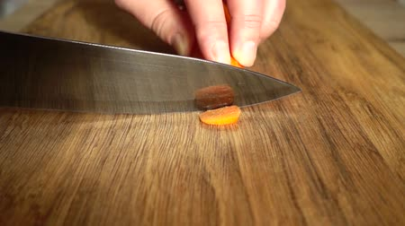 picado : The cook cuts carrots with a knife. Slow motion. Stock Footage