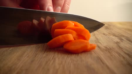 picado : The cook cuts carrots. Slow motion. Stock Footage
