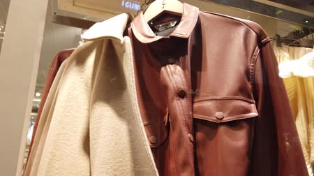 ugró : Clothes in shop. Shopping. Sweaters, shirts, jackets.