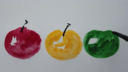 kleks : Drawing on paper with watercolor paints. The draw apples. Wideo