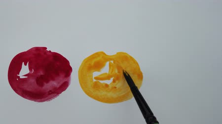 ブロット : Drawing on paper with watercolor paints. The draw apples. 動画素材