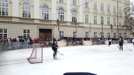 mistrovství : LVIV, UKRAINE - FEBRUARY 23, 2020: The hockey match between representatives of the armed forces of Canada and the hockey team Halytski Levy in Lviv.
