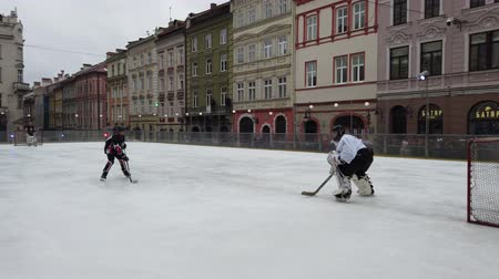 LVIV, UKRAINE - FEBRUARY 23, 2020: The hockey match between representatives of the armed forces of Canada and the hockey team Halytski Levy in Lviv.