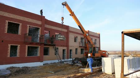 housing problems : Crane at a construction site, construction townhouse Stock Footage