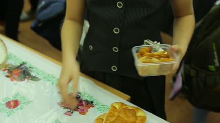 pastry purse : Charity fair, buyers buy chips, close-up in the gymnasium